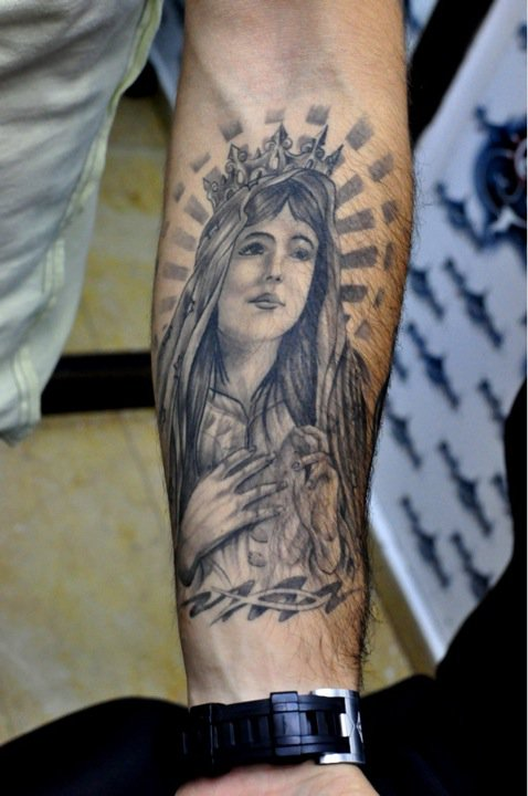 Artist magazine pdf angel forearm tattoos quotes about for Angel tattoos on forearm