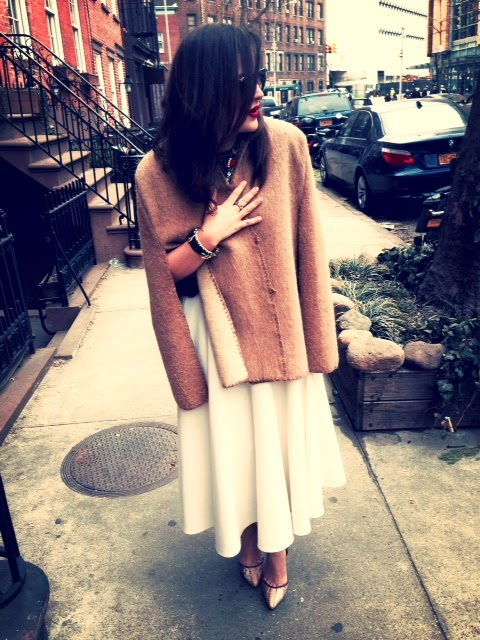 feminine vintage outfit inspiration, streetstyle NYC, white midi length skirt with tan cape, fashion inspiration