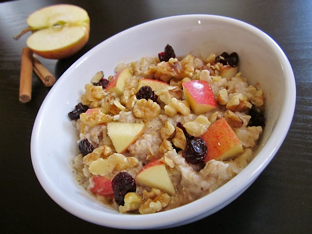 cooked oatmeal with fresh fruits,dried fruits and nuts