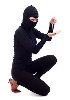 Female burglar holding diamond bracelet
