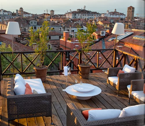 another way of enjoying the romantic Venetian city by relaxing on the balcony
