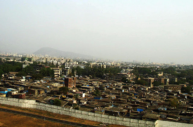 slums adjoining airport runaway