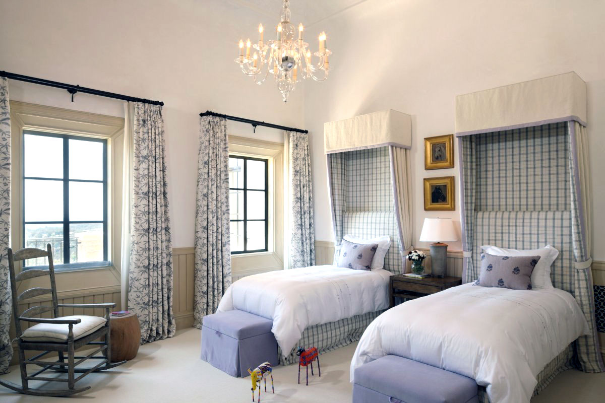 Bedroom with twin wall mounted canopy beds