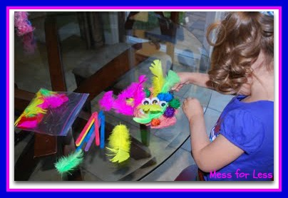 photo of: Playdough Monster with Feathers from Mess for Less (via Monster RoundUP from RainbowsWithinReach) 