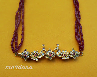 kundan pendant with peacock design