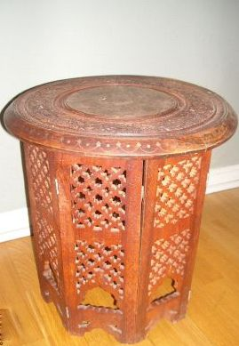 Fancy The closest piece I could find that had that Moroccan style was this one However I need a coffee table not an end table