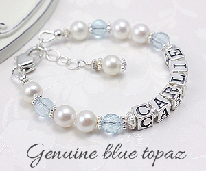 baby bracelet in cultured pearls with blue topaz birthstones