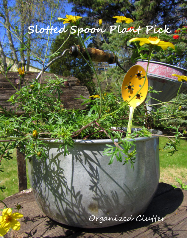 Slotted Spoon Repurposed Plant Pick www.organizedclutterqueen.blogspot.com