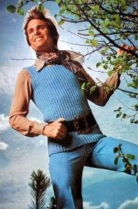 Happy man in blue sweater vest with belt.