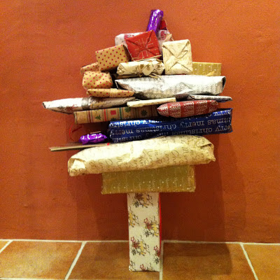 A number of parcels stacked and balanced into the shape of a tree.