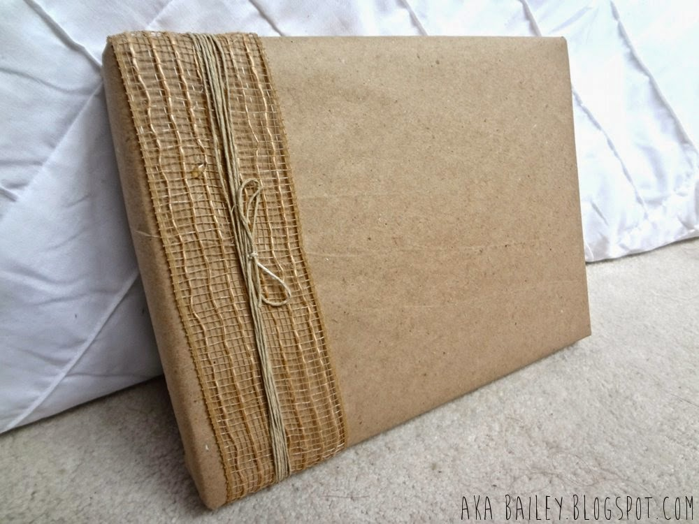 Brown paper gift wrap with burlap ribbon and hemp twine