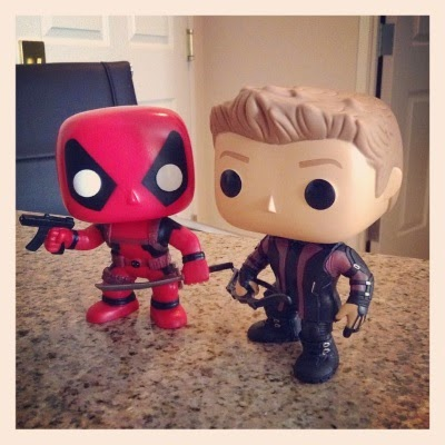 Tiny Deadpool and Tiny Hawkeye stand side by side.