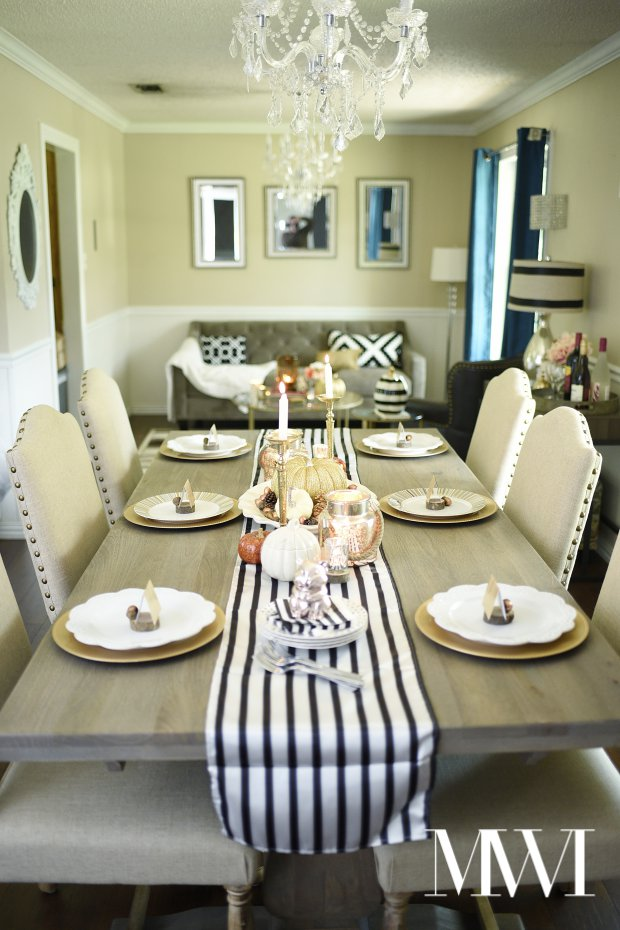 This dining room and seating area is so glamorous, yet looks cozy and inviting. The use of candles gives a warm glow, and the black and white touches add a modern touch.