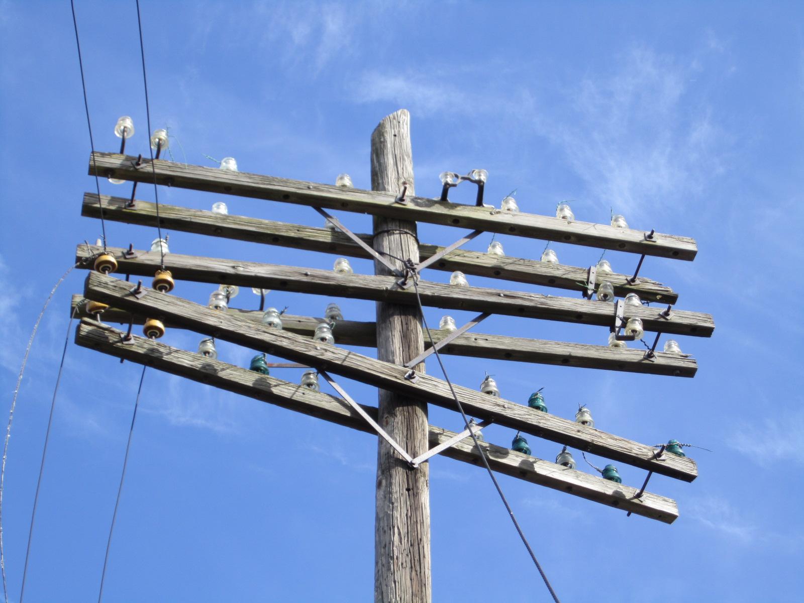 Recumbent conspiracy theorist insulators in the wild for Power line insulators glass
