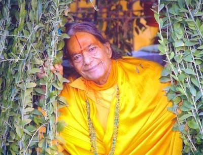 Shree Maharajji pictured next to a tree
