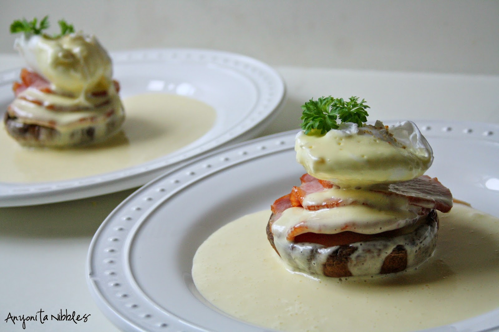 She used grilled portabellos to replace the brioche or English muffins in this eggs Benedict dish and make it gluten free from Anyonita Nibbles