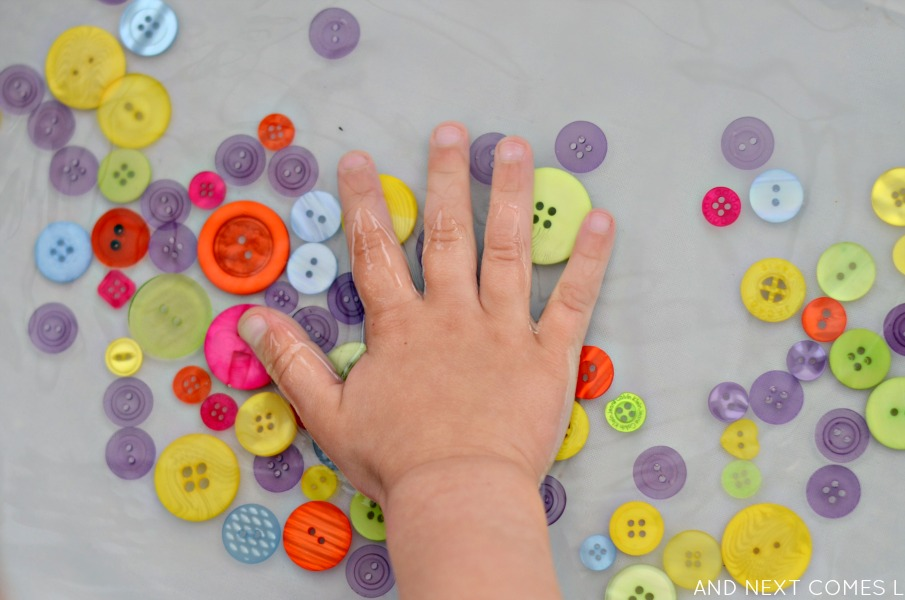 Button sensory soup: fine motor water sensory play for toddlers & preschoolers from And Next Comes L