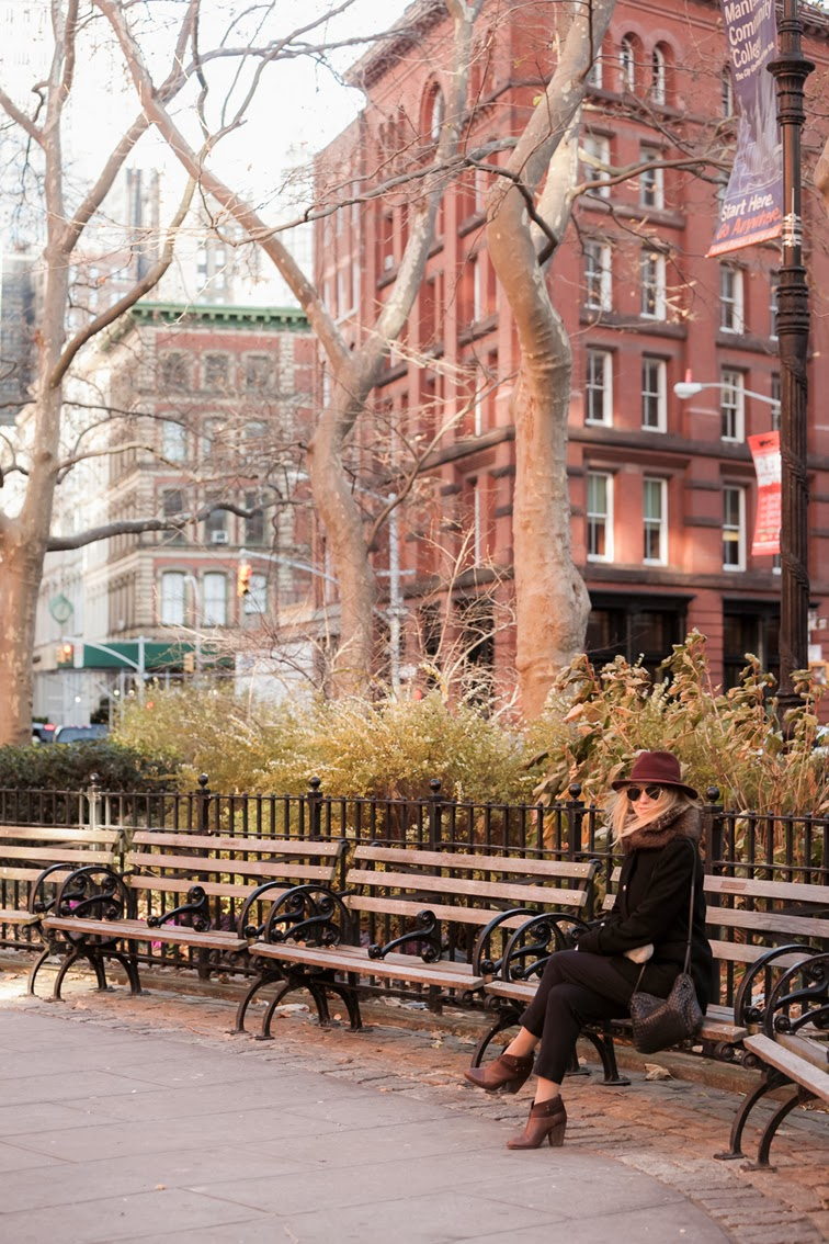 NYC Tribeca park bench red brick buildings