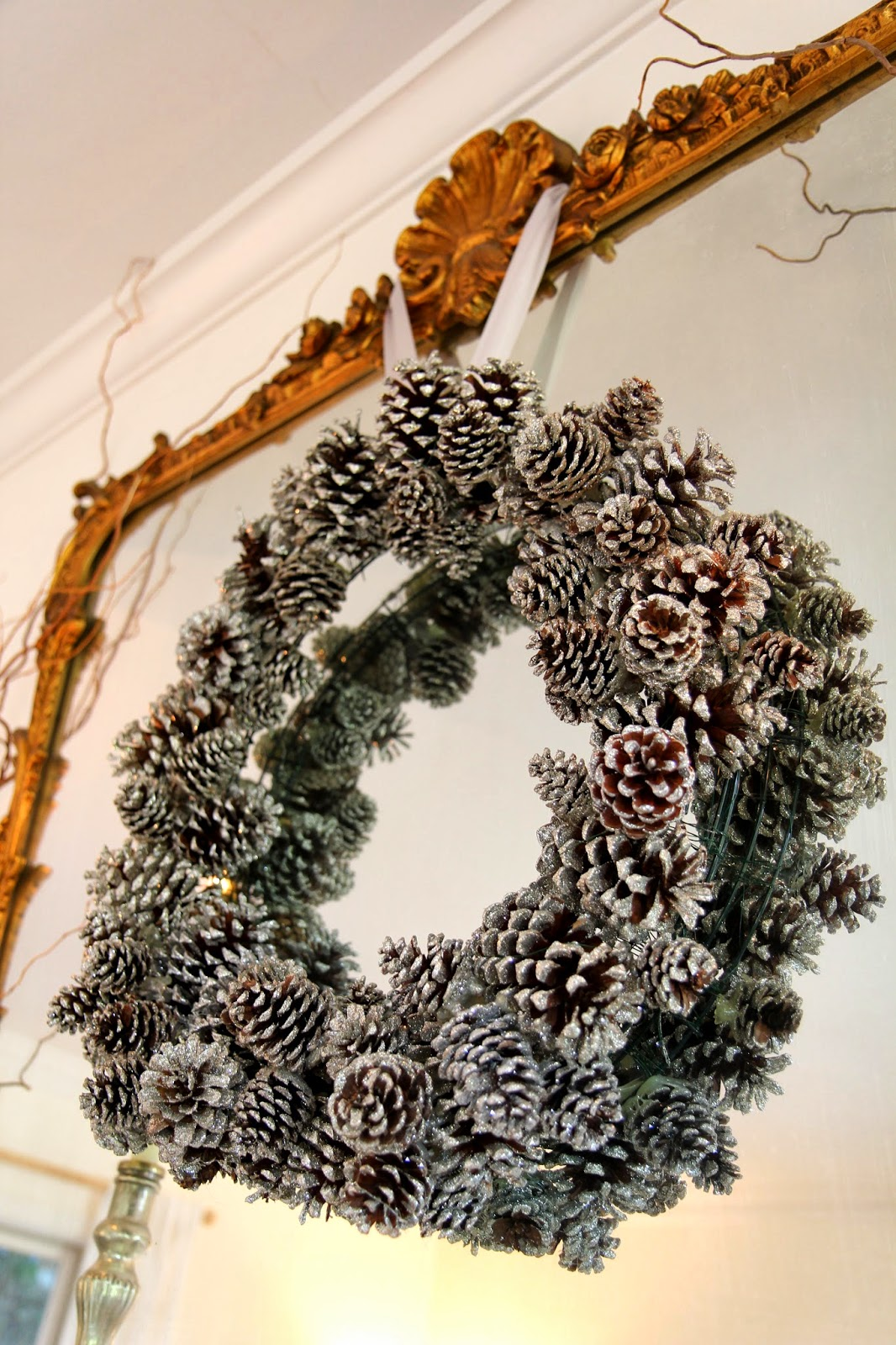 Glittered Pinecone Wreath on Mirror