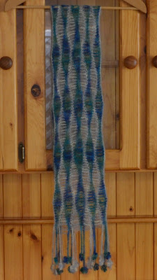 Silk mohair scarf in blue-green and silver-grey wavy patterns along the length of the scarf and finished with decorative fringe.