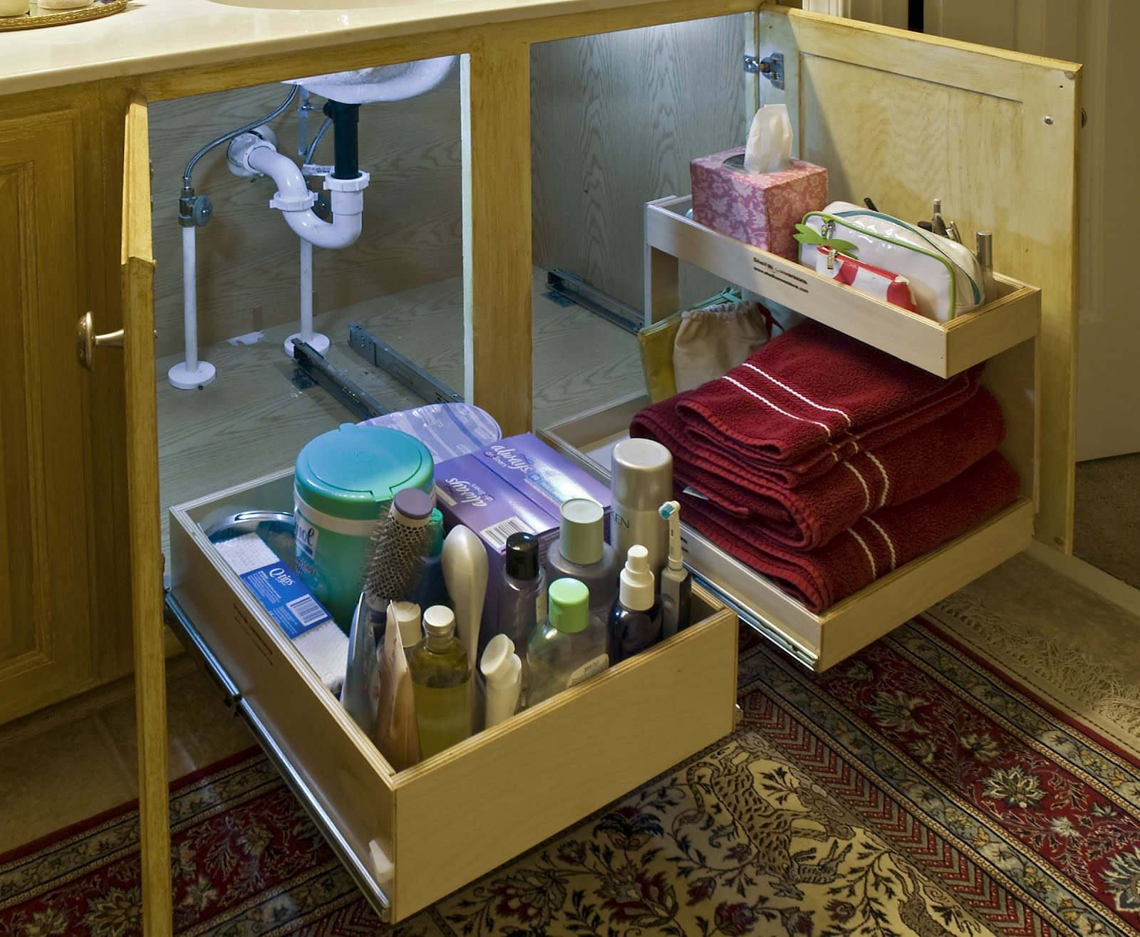 Woodmaster woodworks inc solving the under the sink for Bathroom cabinet organizer ideas