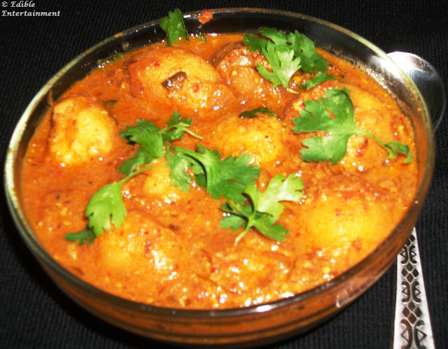 ... step by step pictures link to this recipe http foodomania com dum aloo