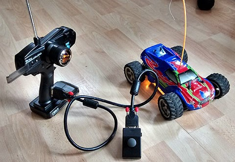 One handed adapted radio controlled car.