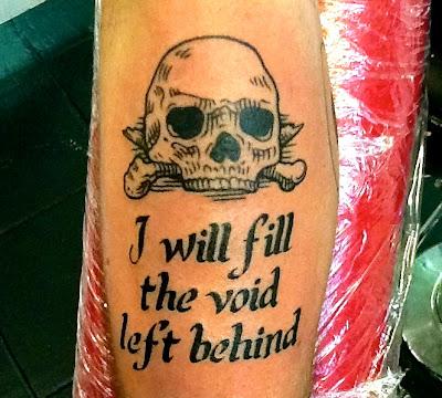 Skull tattoo; linework;script