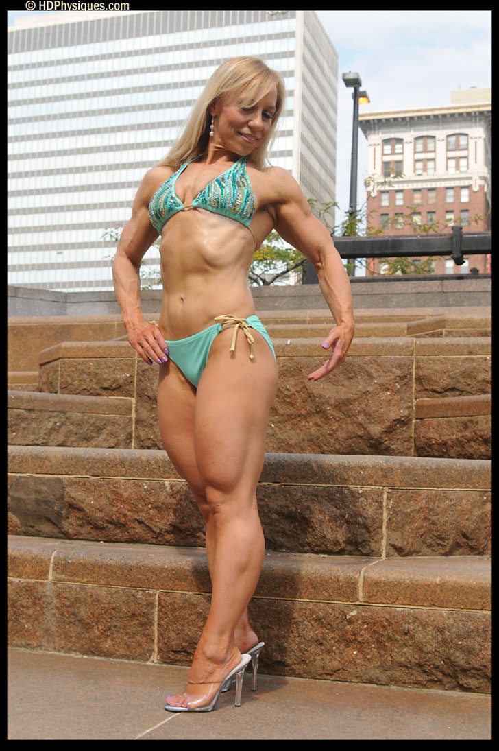 Wynne Regan Posing Her Muscular Physique In A Bikini And Heels
