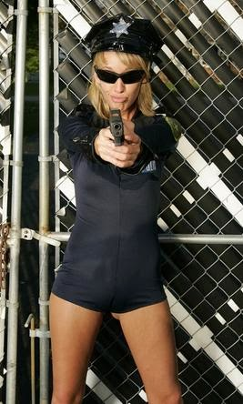 Blonde cop with a gun