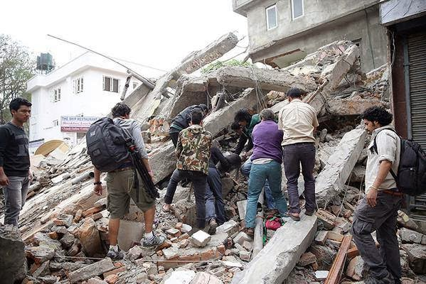 Ekantipur is showing footage of bodies being piled up outside buildings that have collapsed