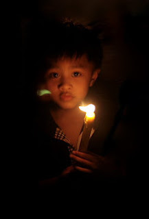 Kid holding a candle - LIfe is beautiful