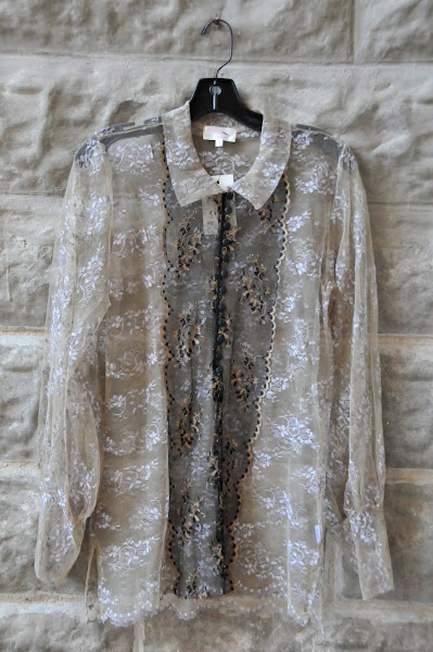 Metallic Lace blouse with buttons.  $134