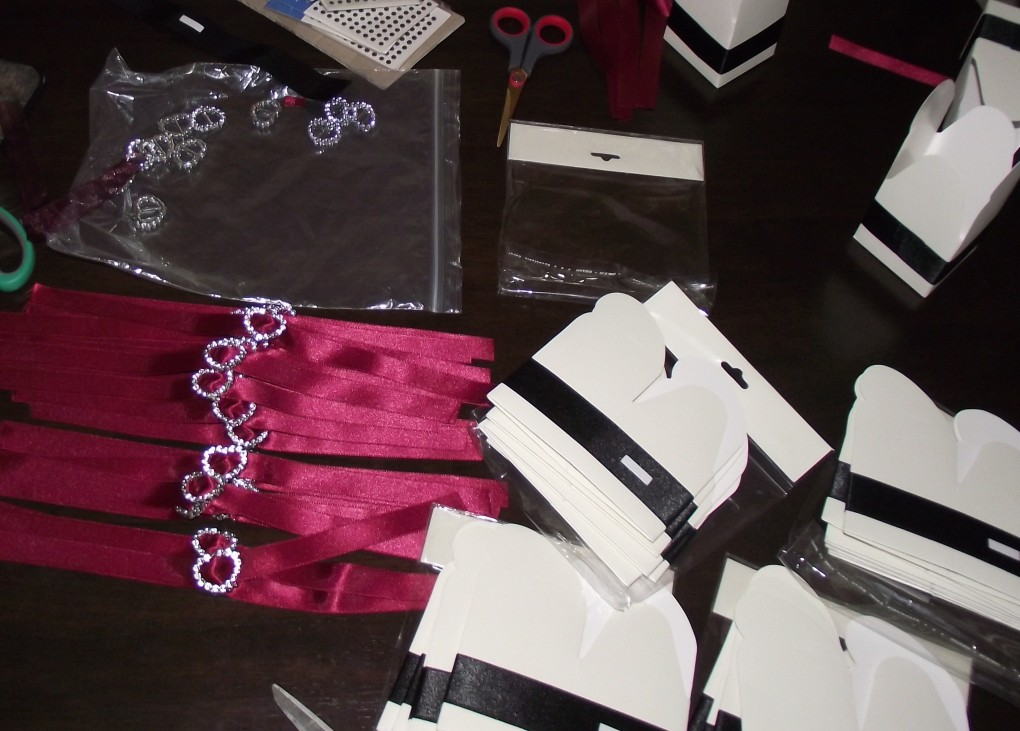 Wide Black ribbon with burgundy ribbon silver heart around the box