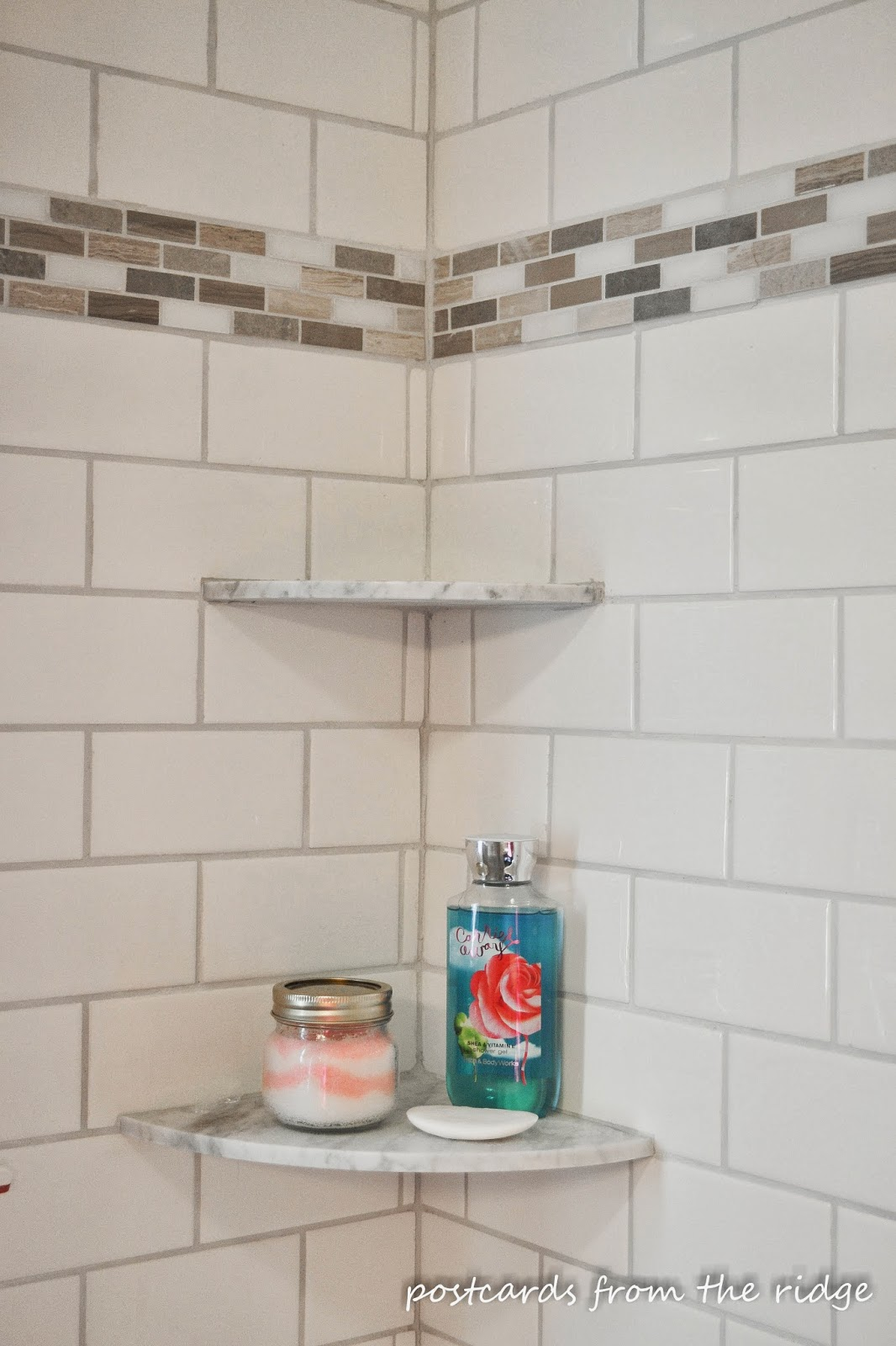 Great idea for a place for shampoo and soap in the shower.  Lots of other great bathroom ideas here.