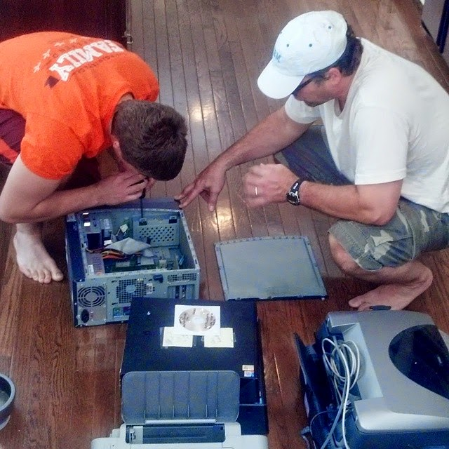 Father and son help needy children in Africa by repairing old computers.