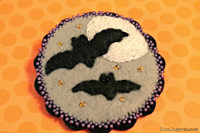 Beads, felt & embroidery for a sweet little Halloween Pin by Lisa Leggett