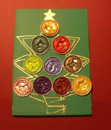 tarjeta de navidad con capsulas de caf recicladas