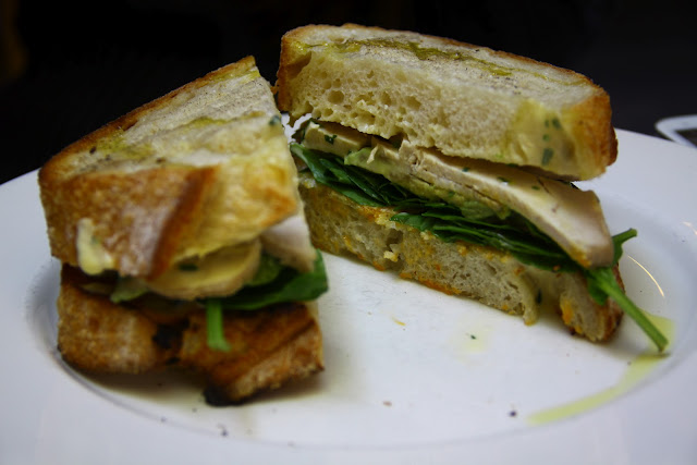 ... sandwich with avocado chive crème fraiche and baby spinach, $12