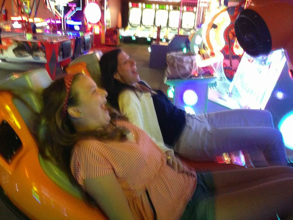 Girls screaming on simulator ride.