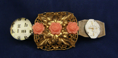 upcycled barrette with antique watch parts and gold-toned center piece with coral roses