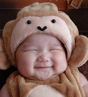senyum sampai ke telinga