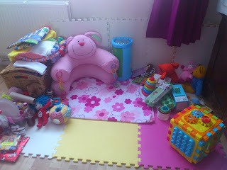 nice clean and tidy play mat area with rabbit baby nest