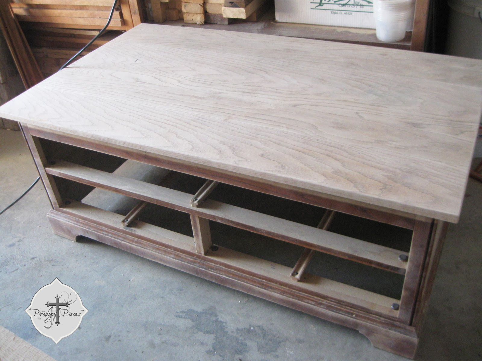 Sunbleached Stained Oak Coffee Entertainment Table Stand via Prodigal Pieces