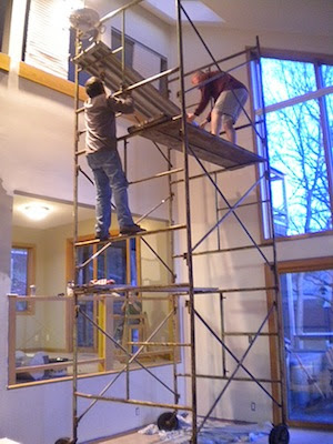 Painting the living room with scaffoling