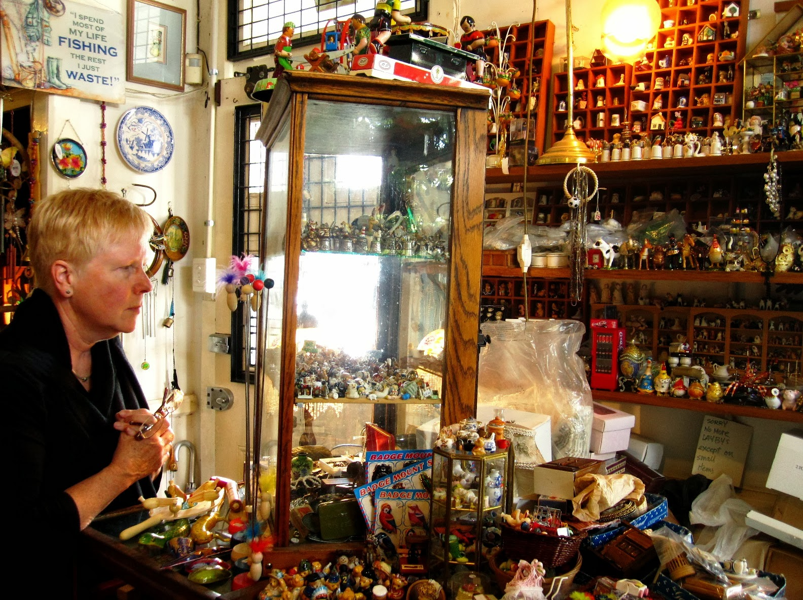 Browsing the miniatures for sale at The Old Tythe Barn dolls house shop at Blackheath