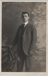 Vintage postcard of man posing for photograph
