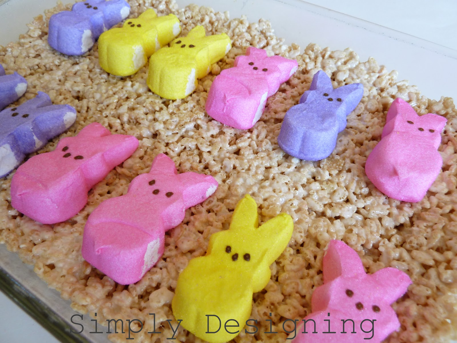 press the treats into the pan, gently press your Peep Bunnies or Peeps ...