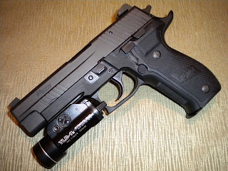 SIG Sauer P226 Elite Dark with attached Streamlight TLR-1s weapon light