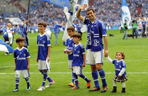 Departing Spain striker Raúl waves goodbye to the Schalke fans with his family